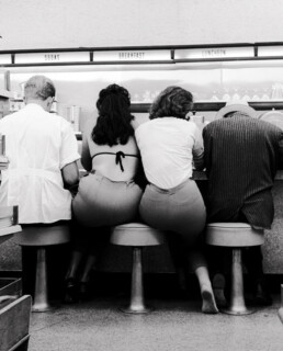 women at lee drugstore counter, 1961